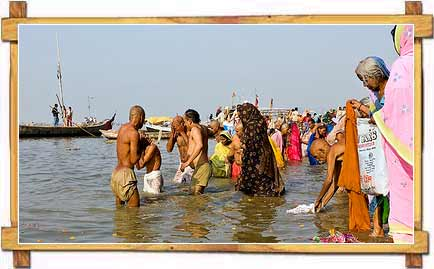Devotees taking bath Sangam, Allahabad