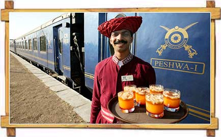 Waiter outside the Deccan Odyssy Train