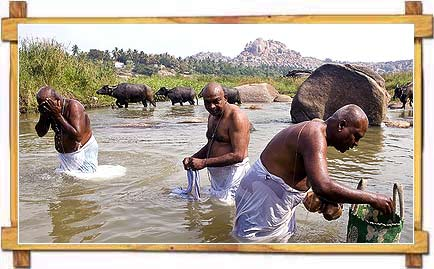 Holy Bath at Tungabhadra in Hampi