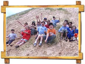Kids Sliding from the Dune Top