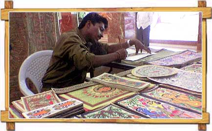 A Painter Indulged In Making Madhubani Paintings