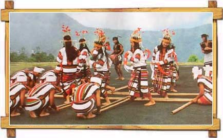 Girls Engaged In Traditional Bamboo Dance