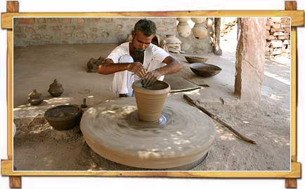 Potter making Pots