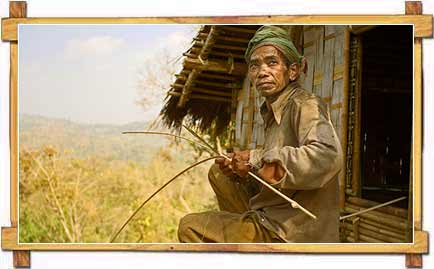 A Tribal Man Creating Magic Out of Cane