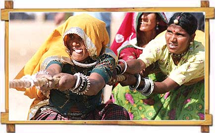 Women take part in Tug of War game at Pushkar fair